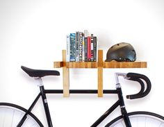Living in a shoebox | This book shelf also functions as bike rack, hooks and book ends