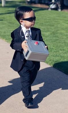 How cute is this top security ring bearer? We love this spin on walking the rings down the isle. Tag a friend who would love this!  #PSWeddingsAndEvents #RingBearer #TopSecurity #WeddingHumor