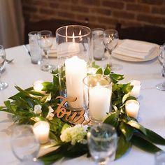 Fresh, green and candle lit garland centerpiece at Deity. Candle Arrangements, Wedding Flower Arrangements, Wedding Table Decorations, Wedding Table Settings, Simple Wedding Centerpieces, Table Verte, Floral Wedding, Wedding Flowers, Green Centerpieces