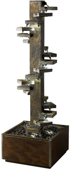 La fontaine en cascade pierre de schiste en spirale offre pléthore d'attributs design en ces mini réservoirs en pierre de schiste disposés en escalier le long de cet axe central, qui s'illuminent d'une lumière violet-turquoise, grâce aux diverses barrettes de lumière LED disséminées à plusieurs niveaux des mini-coupes. Garantie 1 an, cette oeuvre sculpturale imposante de la maison design CACTOSE éveille aussi bien la vue que l'ouïe, pour une ambiance liquide propre à l'environnement…