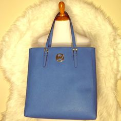 Authentic Michael Kors Jet Set Heritage Blue Tote Primed for work days and perfect for weekend ways, this classic tote travels with ease wherever you want to go. Made of Saffiano leather in Heritage Blue, this bag features adjustable dual shoulder straps. (L) 15 x (H) 15 x (W) 4 inches (has little scratch on Mk metal) Michael Kors Bags Totes