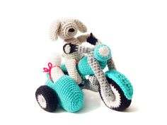 Inspired by lovely vintage motorbikes and cute dogs, this amigurumi pattern was created! Meet Marlon, the biker dog and his inseparable ride!