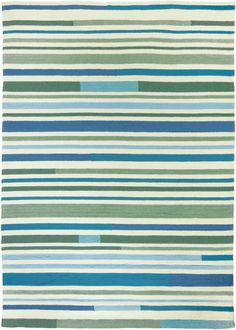 Varying stripes in Sea Breeze colors create the captivating pattern in this coastal indoor or outdoor area rug.