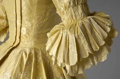 Detail sleeve cuffs, robe à l'anglaise, probably Great Britain, 1760s. Yellow silk embroidered with floral motifs in white silk.