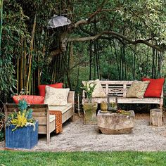 """""""Magic Grove"""": An outdoor living room is tucked under a grove of bamboo, providing a delightful surprise to visitors. A gravel square carved into the grass delineates the room. - From Cottage Living Outdoor Seating Areas, Outdoor Rooms, Outdoor Gardens, Outdoor Living, Outdoor Furniture Sets, Wicker Furniture, Porches, Pea Gravel Patio, Paved Patio"""