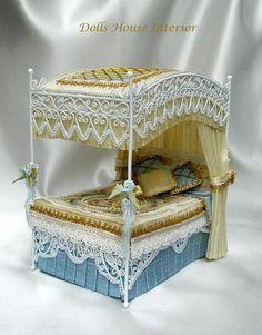 white wicker four-poster bed with silk fabrics ~ http://dollshouseinterior.co.uk/images/4post1.jpg#