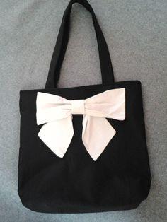 borsa in tessuto di cotone con fiocco applicato