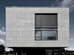 Equitone fiber cement facade panels through color, exposed and concealed fastening options, ETERNIT lineage, 4x10 max panel size  project: Belgium - Temse - office building