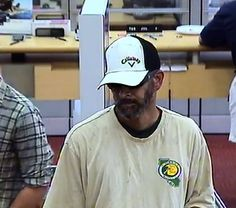 "Can you identify this bank robber? If so, give us a call at 650-903-6395 and reference case number 14-3389. Anonymous tips can also be sent via text to 274637. Please include ""mvtips"" in the body of your message so that we receive it. Learn what happened >> http://mountainviewpoliceblog.com/2014/07/02/can-you-identify-this-bank-robber/"