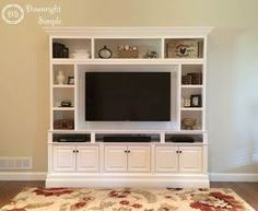 "This is my DIY  Built In / Wall Unit made for 60"" TV.  I used three in stock brown maple Home Depot upper kitchen cabinets (30"" wide x 18""..."