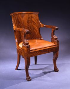 An Empire Mahogany Fauteuil de Cabinet en Gondole, French Circa 1805-1810 Height: 33 inches (84cm.) Length: 24 ½ inches (62 cm.) Depth: 20 inches (51 cm.)