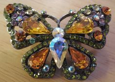 #gotvintage #vintage #jewelry Vintage Amber Butterfly, Clear, and Yellow Rhinestone Silvertone Brooch  Measures 2 x 1 3/4 approximately. Nice silver tone metal with working C