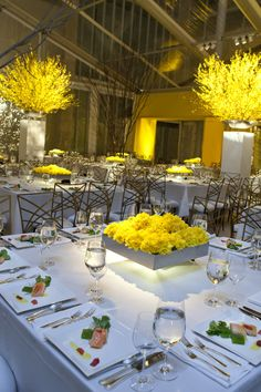 Wow. Yellow done right. Those chairs! Square tables. The spotlights are key. Beautiful and not in the budget ;) Blue Plate Catering in Chicago