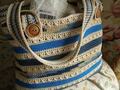 Crochet bag w/button on straps.