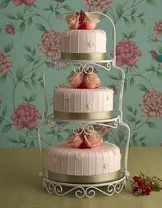 What about something like this for the cake? Still do the cake you want, but I have a stand like this... it would look pretty.