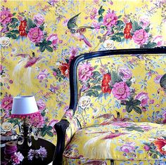 Matching floral wallpaper and couch!