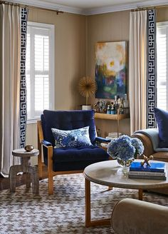 Navy and tan room with greek key trim curtains | Traci Zeller design via Centsational Girl