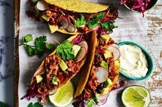 Spicy pulled pork and black bean tacos