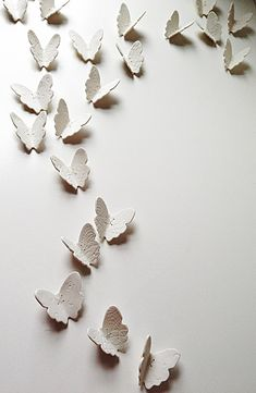Titled Lace Wings, this set of 21 3D porcelain wall art butterflies were inspired by the insects of the same name. They are easy to install on your wall in any room in your home and the wings will cast shadows that change as the light changes throughout the day. Every butterfly sculpture is unique and is hand crafted from translucent white porcelain. The texture and pattern on the wings comes from pretty antique lace embroidery and crochet, and they are finished with stitches of your…
