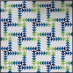 Sampaguita Quilts: A Gaggle of Goslings. Block A is 4 spokes of 3 green flying geese pointing in, block B is 4 spokes of blue pointing out