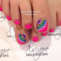 A rather interesting looking and bright toenail art design. The nails are coated with matte hot pink nail polish. The big toenails are then designed with multiple colors of curve shapes and polka dots. A variety of bright polishes are used such as white, green, blue and violet.