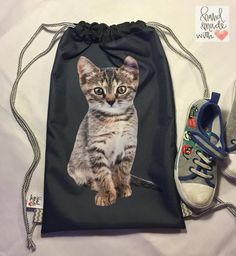 A personal favorite from my Etsy shop https://www.etsy.com/listing/546635636/back-pack-little-kitten