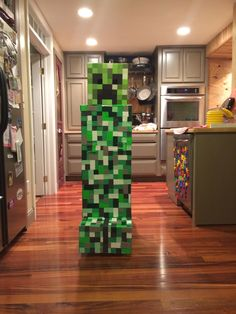 "Creeper Costume- store bought head- U-haul - golf bag box: glue one side shut- cut circle for head - box rests on shoulders- cut to length - about 9 inches off floor- cover with green wrapping paper then modge- podge 1.5""/3.00"" rectangles all over - various shades of green... Make L shaped feet in front and back... Cut hand holes that flap open, secure with strong to pull closed- green duct tape comes in handy throughout good luck!"