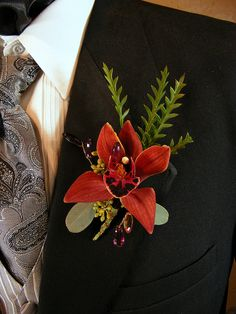 Beautiful deep orange Cymbidium orchid Boutonniere. Great for a special occasion. Make sure to order the matching corsage!