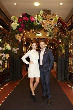 This is random re-pinning a pic of people, but just check out the most beautiful flower arrangement behind them. Stunning. Colours are perfect to say the least, and perfectly suited to the QVB interior.