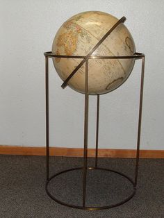 A VERY NICE MID CENTURY MODERN BRASS FLOOR GLOBE WORLD ATLAS BY PAUL MCCOBB. EXCELENT CONDITION. MEASURES 28 1/2H X 19 1/4W.