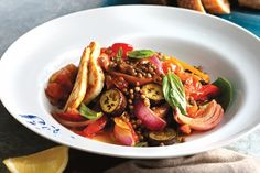 Stylish, filling and meat-free, this Middle Eastern inspired warm salad is a breath of fresh spring air. Team warm lentils and sauteed vegies with wilted greens and golden fried haloumi.
