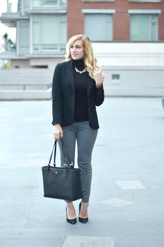 A statement necklace worn over a turtleneck. Effortless work chic for your fall/winter office looks! Click through for all the outfit details!