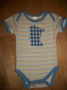 This sweet , new, baby MN baby onsie will make any heart melt! Let the baby wear it with big Minnesota pride! Stripes & checks are the best combo!-SOLD