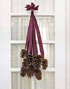 Hanging Pine Cones for a door decoration or mirror or even from chandelier. Great for josh Xmas decor. 6443045665:Yahoo:photo