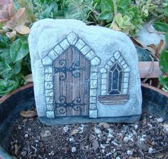 LITTLE CASTLE DOOR- Hand painted rock for the porch or garden. Can be…