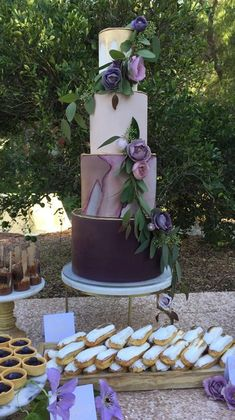 Elegantly rustic purple and white wedding cake; Featured Cake: Hey-There Cupcake!