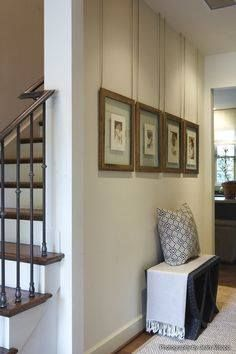 Here's a unique way to hang custom framed art, which adds a lot to the overall look... Hang your custom framed pieces from roping, attached to the wall, up close to the ceiling. Select a rope color similar to that of the frame finish and elongate the look of your art, enhancing the ceiling height. A smart and stylish look! | Larson-Juhl Custom Frames