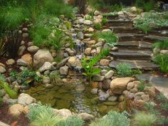 Garden fountain feature with pond and flagstone steps. Such a pretty idea and the waterfall looks so natural, like you've just stumbled upon it in the woods somewhere.