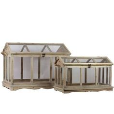 Amazon.com: Urban Trends Collection UTC40101 Wooden Terrarium, Set of 2: Furniture & Decor  I'd love to be able to put a little snow scene in these.  Then change it out to an Easter scene or something for Halloween.  Pretty expensive though.
