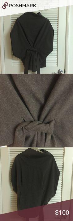 Obakki brown fleece poncho Obakki brown belted poncho.  60 percent fleece wool and 40 percent angora.  Lining is rayon Obakki Sweaters Shrugs & Ponchos