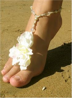 Flower Beach Wedding Footwear - http://casualweddingdresses.net/beach-wedding-ideas-be-a-stunning-beach-bride-on-your-own-beach-wedding/