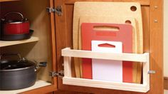 Store cutting boards in your cabinets with a magazine rack.