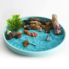 Made to Order: The pebbles, mini shells, and driftwood will vary slightly. Please see fourth photo for examples. Miniature desktop zen garden featuring mini ocean figurines! With this DIY Zen Kit you can create your own little ocean scene. Leave just the sand or arrange the pebbles in