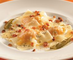Pumpkin ravioli with bacon sage sauce. Recipe by Paul Parker; photo by Chris Cassidy.