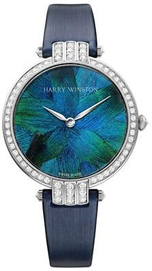 Case: 18k white gold, diameter 36 mm Dial: marquetry of real blue peacock feathers Gem-Setting: 96 brilliant-cut diamonds (approximately 1.6 carats). Case set with 67 diamonds (1.4 carats), including 1 diamond on the crown (0.02 carat) and 4 diamonds on the strap integration parts (0.08 carat)