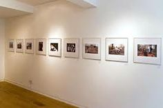 photography exhibition // simple design; frames all the same size; white frames