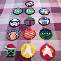 Variety of ornaments. (Piranha plant from Mario on top, second row is 3 from Breaking Bad, third row is a storm trooper, bubba fet and r2d2 from Star Wars, fourth row is Thor, iron man and the hulk from the avengers, and the fifth is a creeper from Minecraft and two Star Trek logos.) All are $5 each.