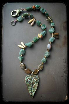 """Rough apatite, bronzite, and czeck glass beaded necklace with lampwork accent beads by Ellen Dooley, and ceramic owl pendant by Thea Elements. Brass lobster clasp in back with small brass bee bead. This necklace measures about 17.5"""""""