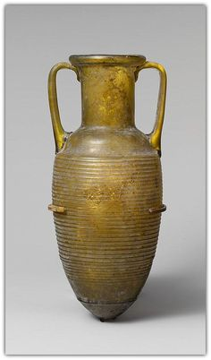 Glass amphora (jar). Period: Early Imperial. Date: early 1st century A.D. Culture: Roman. Medium: Glass; probably blown in a three-part mold.