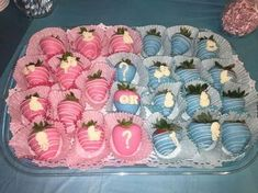 Put white and dark chocolate covered with pink and blue drizzle in colored paper cups